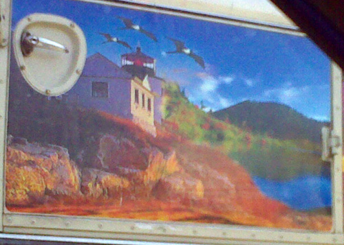 Landscape painting on the side of a bus